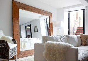 love the huge mirror on the floor...always makes a statement in a room w/out lot of other wall decor