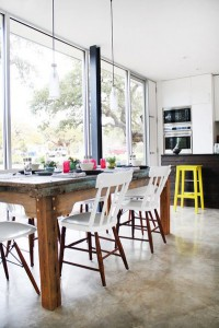 Rustic table, wall windows and half painted chairs with pop of yellow. Modern and comfortable.