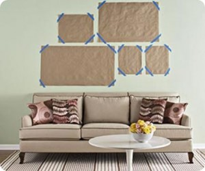 Easy way to arrange pictures. Nail hole and then tear away paper. Now, where do you get brown paper from?
