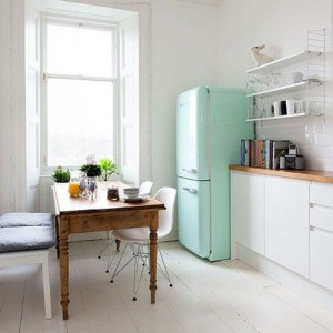 small kitchen spaces:  About the same shape as my kitchen. Would look great with a little table there :D
